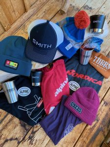 various ski brand shirts and hats