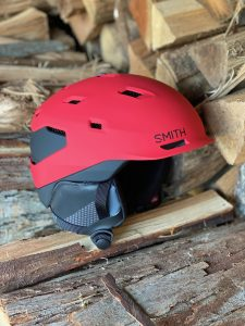 red and black helmet on the wood pile